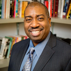 Portrait photograph of Prof. Travis Dixon in office setting